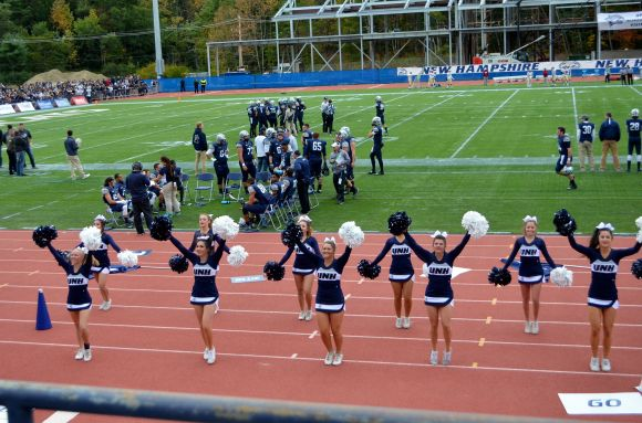 University of New Hampshire cheerleaders perform at the 2015 homecoming game against Elon University. Photo/Meg Heckman
