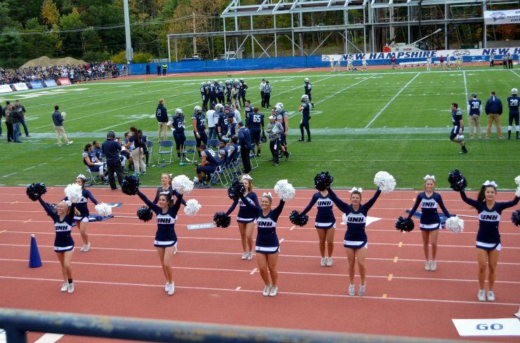 University of New Hampshire cheerleaders perform at the 2015 homecoming game against Elon University. Photo/Meg Heckman